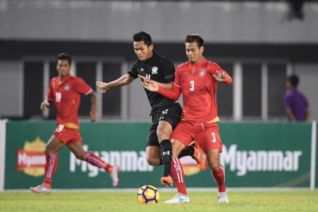 Thailand's Mongkol Thossakrai, left, vies with Myanmar's Zaw Min Tun.