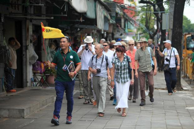 A tour group visits Pak Khlong Talat area. Improving safety and security is one of the tactics experts have prescribed to draw more visitors to Thailand.CHANAT KATANYU
