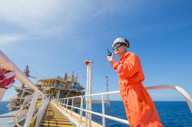 A PTTEP worker in the Bongkot offshore gas field. PTTEP says it will approach Royal Dutch Shell about buying the latter's stake in the field.