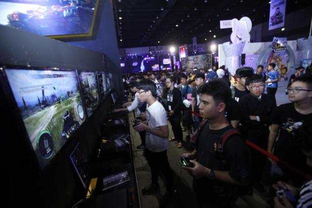 Visitors enjoy video games at a game show festival held in Bangkok. Games are a relatively unexploited area for advertisers. THANARAK KHUNTON