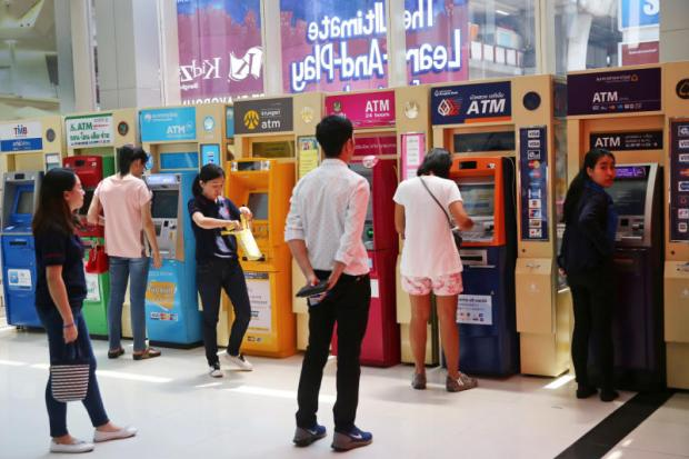 ATMs of various banks at a shopping mall. The Bank of Thailand says the bad-loan ratio of commercial banks will crest above 3% before gradually falling next year.