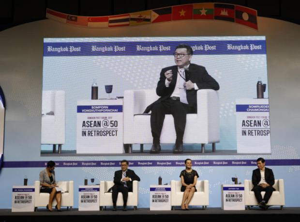 Mr Somporn (second left), Ms Somruedee and Mr Tan at the panel discussion moderated by Pavida Pananond (far left) of Thammasat Business School. (Photo by Pattarapong Chatpattarasill)