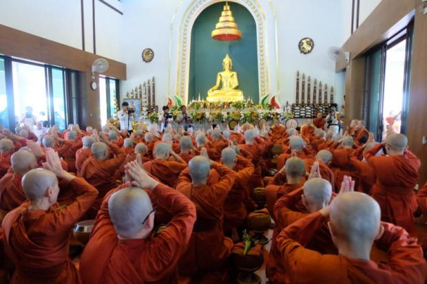 Newly ordained samaneri or female novices pay respect to an image of the Buddha at the end of the ordination ceremony at Nirotharam monastery in Chiang Mai. (Photo by Sanitsuda Ekachai)