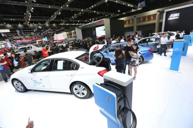 Electric vehicles are displayed at a motor show held at Impact Muang Thong Thani. The government may pass battery standards for EV imports. PHRAKRIT JUNTAWONG