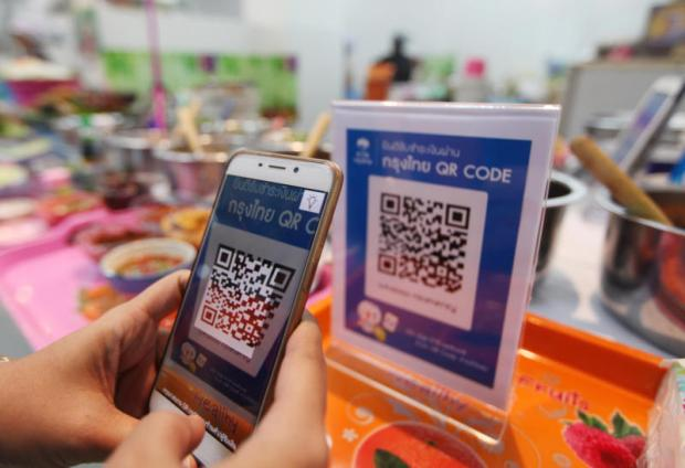 QR code payment through bank networks is available at more and more shopping spots. (Photo by Thiti Wannamontha)