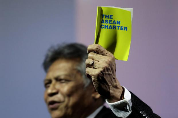 Surin Pitsuwan holds the Asean Charter booklet at the Bangkok Post Forum 2017 in November. Of the 13 heads of Asean in its 50-year history, many see Surin as having been the most formidable and effective. PATIPAT JANTHONG
