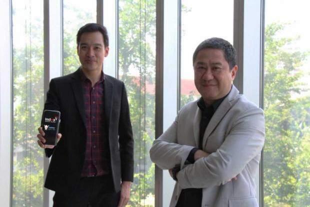 Happio Co general manager Khanit Aramkitpota, left, and Index chief executive Kriengkrai Kanjanapokin. The two companies are partnering to tap into Myanmar consumers with digital marketing strategies.
