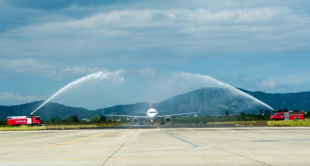 Thai Vietjet Air's Airbus A320 gets a water cannon salute upon arrival at Lien Khuong airport in Lam Dong province after Monday's maiden Bangkok-Dalat flight.