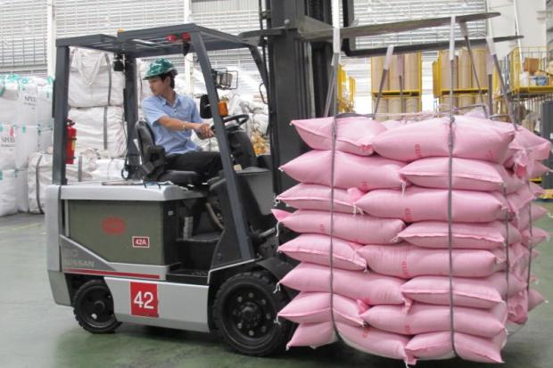 A worker drives a forklift to load rice bags in Ayutthaya.  WALAILAK KEERATIPIPATPONG