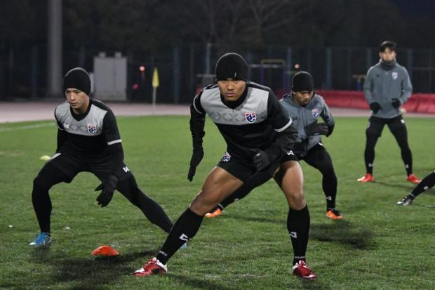 Thai players train on the eve of their match against reigning champions Japan.
