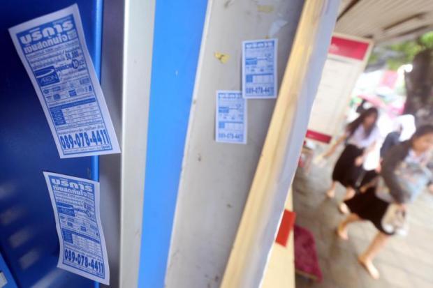 Leaflets advertising quick loans are rampant in Bangkok. WEERAWONG WONGPREEDEE