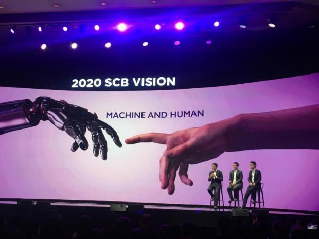 Mr Arthid (first from left), Thana Thienachariya, chief marketing officer, and Arak Sutivong, senior executive vice-president, deliver SCB's new vision.Somruedi Banchongduang