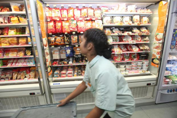 An employee working at a 7-Eleven store in Suvarnabhumi airport. SOMCHAI POOMLARD