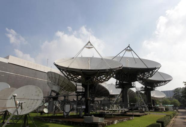 Satellite dishes stand behind Thaicom's headquarters in Nonthaburi province. TAWATCHAI KEMGUMNERD