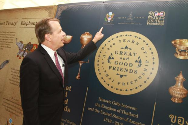 US Ambassador to Thailand Glyn T Davies points at an exhibition marking 200 years of Thai-US relations at his residence. The fair, from March 21 to June 30, will showcase gifts exchanged between the two sides' leaders for the first time.Somchai Poomlard