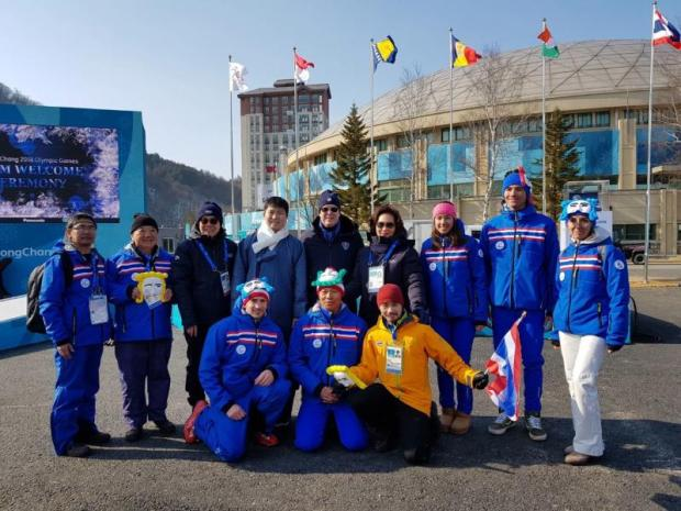 From right, back row, skiers Mark and Karen Chanloung, IOC member Khunying Patama Leeswadtrakul and Prince Albert II of Monaco outside the Athletes' Village on Thursday.