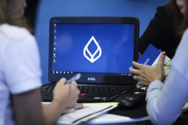 Bangkok Bank's logo appears on an employee's computer screen. The bank questioned TDAX's lack of an operating licence.