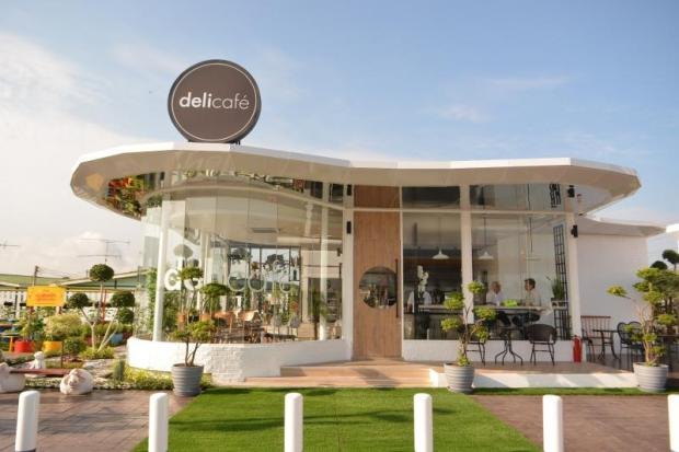 A Deli Cafe shop is located near a Shell petrol station on Rama III Road. The company wants to emphasise its non-oil business.