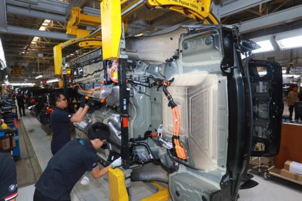 Workers on BMW's PHEV assembly line at Amata City industrial estate in Rayong province.