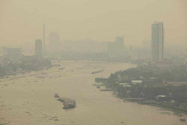 A aerial view shows Bangkok blanketed by haze. Poor air quality has become a concern in the capital again. (Photo by Pornprom Satrabhaya)