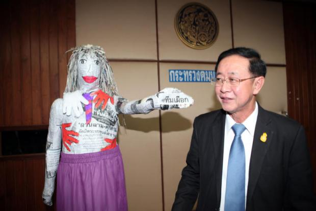 A papier-mache doll in the shape of a woman points her fist bearing the #Team Phuek (meddlesome) hashtag to Transport Minister Arkhom Termpittayapaisith. The doll was presented by women's rights advocates, who urge the ministry to help people harassed on public transport. Apichart Jinakul