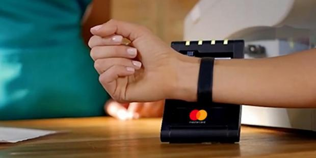 A demonstration of a smartwatch being used to make a contactless payment for Mastercard.