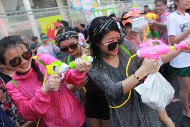 Tourists and locals armed with colourful water guns splash about in Bangkok during Songkran festival.WICHAN CHAROENKIATPAKUL