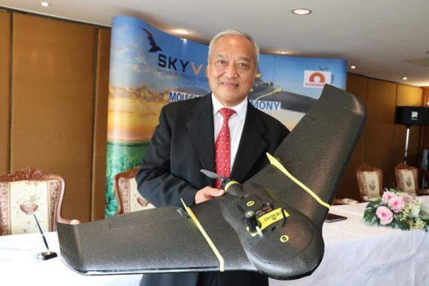 Mr Vivatvong holds a Swiss-made drone used in Skyviv's aerial imagery operations.