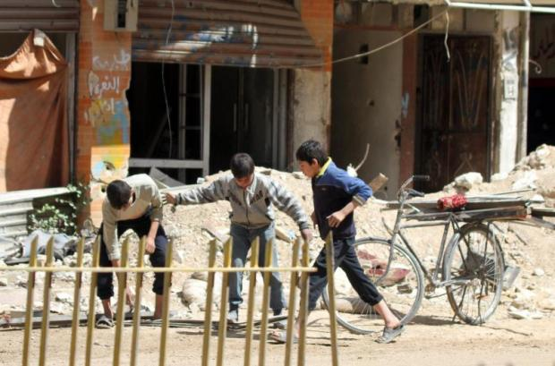 Chidlren play on a street in Zamalka town, Eastern Ghouta, in the suburbs of Damascus, Syria. (EPA photo)