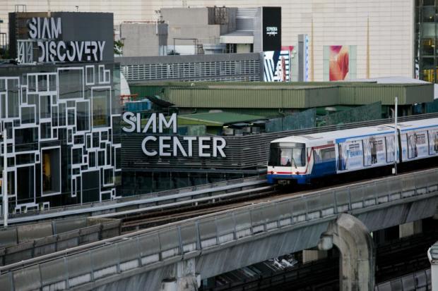 A BTS train moves past a shopping complex area. KRIT PROMSAKA NA SAKOLNAKORN