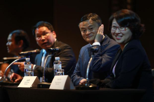 Alibaba co-founder Jack Ma (second right) at Thursday's press conference in Bangkok.