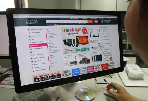 A man checks out products available at Lazada, an e-commerce site in which Alibaba holds a majority stake. KOSOL NAKACHOL