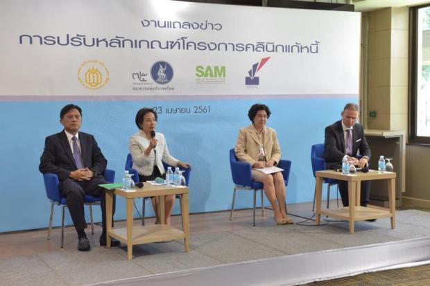 From left, Predee Daochai, Ruchukorn Siriyodhin, Pongpen Ruengvirayudh and Tibor Pandi discussing the Debt Clinic on Monday.
