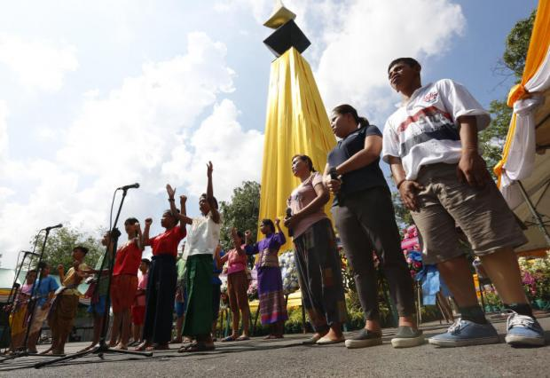 Relatives of the victims of 'Black May', a series of protests in Bangkok in 1992 that was quashed by the military, perform a ceremony to remember those who disappeared, at Suan Santiporn on Ratchadamnoen Road Thursday.Pattarapong Chatpattarasill