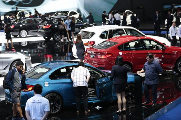 Visitors at a motor show. Research firm LMC reported light vehicle sales across the region rose by 3% to 829,307 units in the first quarter. PATIPAT JANTHONG