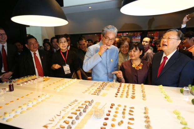 Deputy Prime Minister Somkid Jatusripitak eats a snack displayed at ThaiFex: World of Food Asia 2018.KITJA APICHONROJAREK