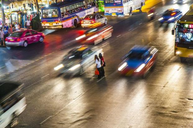 Bumps in the road: Women cross Ratchadamri Road in Bangkok. Every 22 minutes, a human being dies on Thailand's roads. Every 20th overall death in the country is a consequence of a road accident. photo: 123RF