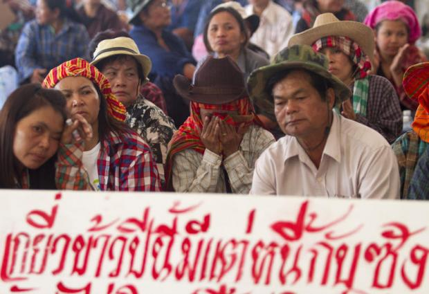 Farmers gathered at the Commerce Ministry in 2014 to call for rice pledging payment. PATTARAPONG CHATPATTARASILL