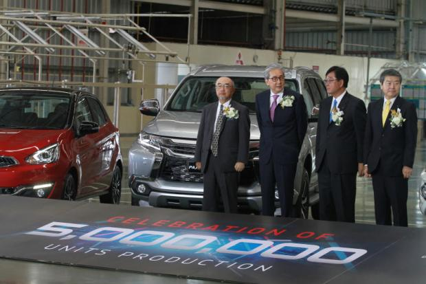 Executives stand in front of Pajero Sport, the 5 millionth vehicle produced by Mitsubishi in Thailand. From left, Japanese Ambassador Shiro Sadoshima, Deputy Prime Minister Somkid Jatusripitak, Mitsubishi Motors Corporation chief executive Osamu Masuko and Morikazu Chokki, president and chief executive of Mitsubishi Motors Thailand. SOMCHAI POOMLARD