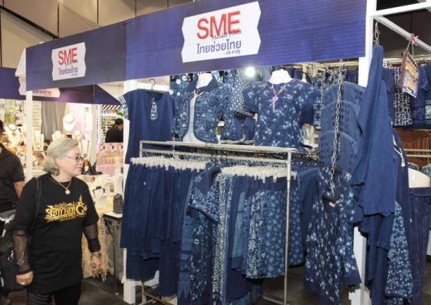 A shop displays indigo-dyed clothes at an SME fair. The central bank is offering SMEs a three-year grace period to comply with a key loan regulation. TAWATCHAI KEMGUMNERD