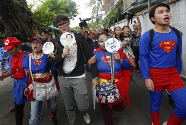 Anti-regime activists, some dressed like popular superheroes and computer game characters, walk to Nang Loeng police station to answer charges stemming from their May 22 rally. (Photo by Pattarapong Chatpattarasill)