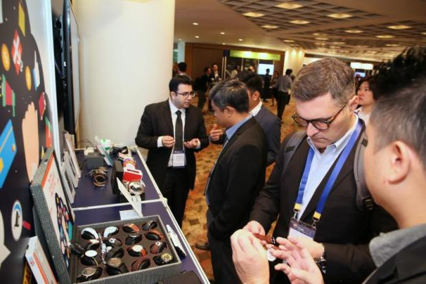 A Visa partner shows how an embedded chip can be used in a traditional watch for device payment.