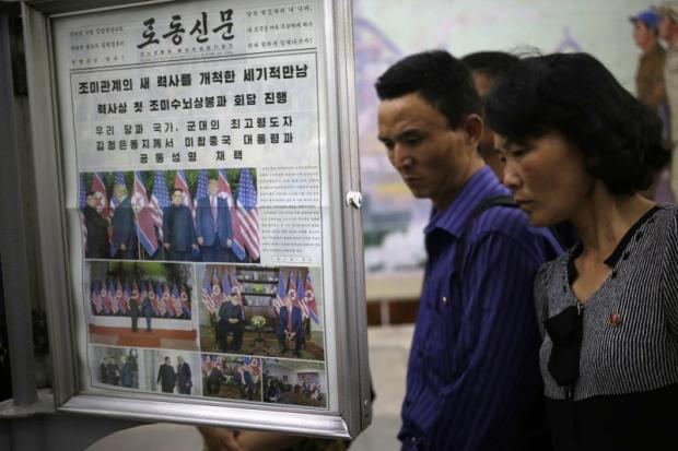 Newspapers fronted US President Donald Trump's summit with North Korean leader Kim Jong-un at the Puhung subway station in Pyongyang. AP
