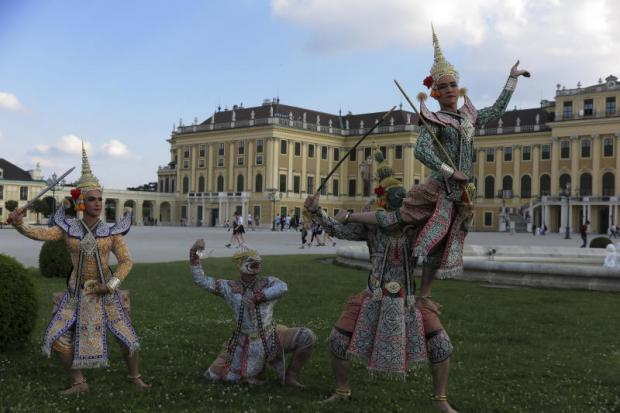 Caught in the moment: A snapshot of dancers performing traditional 'khon' dance in front of the Schlosstheater Schonbrunn in Austria last month. The Ministry of Foreign Affairs and the Ministry of Culture joined hands to promote a Thai cultural roadshow in European countries. The programme's highlight is khon dance but it also includes other artforms such as mask making and cloth weaving. The project is supported by the Queen. Photos: APINYA WIPATAYOTIN