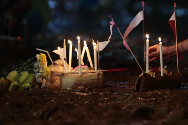 paying respects: Candles lit up to apologise for disrespecting spirits in Tham Luang cave in Chiang Rai. photo: Patipat Janthong