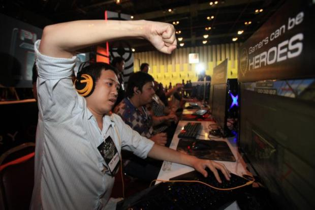 Online gamers at an e-sports competition in Bangkok.(Photo by Patipat Janthong)