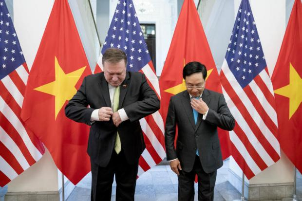 US Secretary of State Mike Pompeo and Vietnamese Deputy Prime Minister and Foreign Minister Pham Binh Minh arrive for photos before a meeting at the Ministry of Foreign Affairs in Hanoi, Vietnam.AP