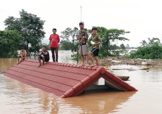 Lao villagers are stranded on a roof of a house after the dam collapsed in a village near Attapeu province, Laos.epa