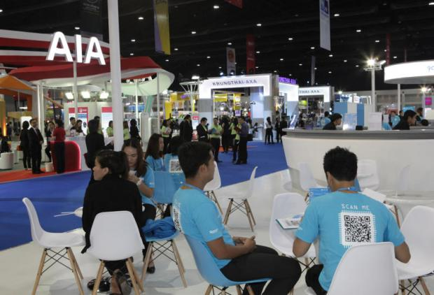 Life insurers showcasing products at an exposition.TAWATCHAI KEMGUMNERD