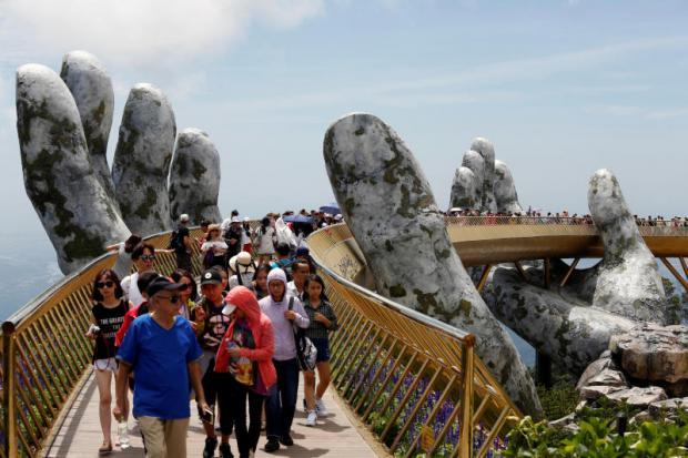 Tourists walk along 'Golden Bridge' in Danang, Vietnam.(Reuters photo)